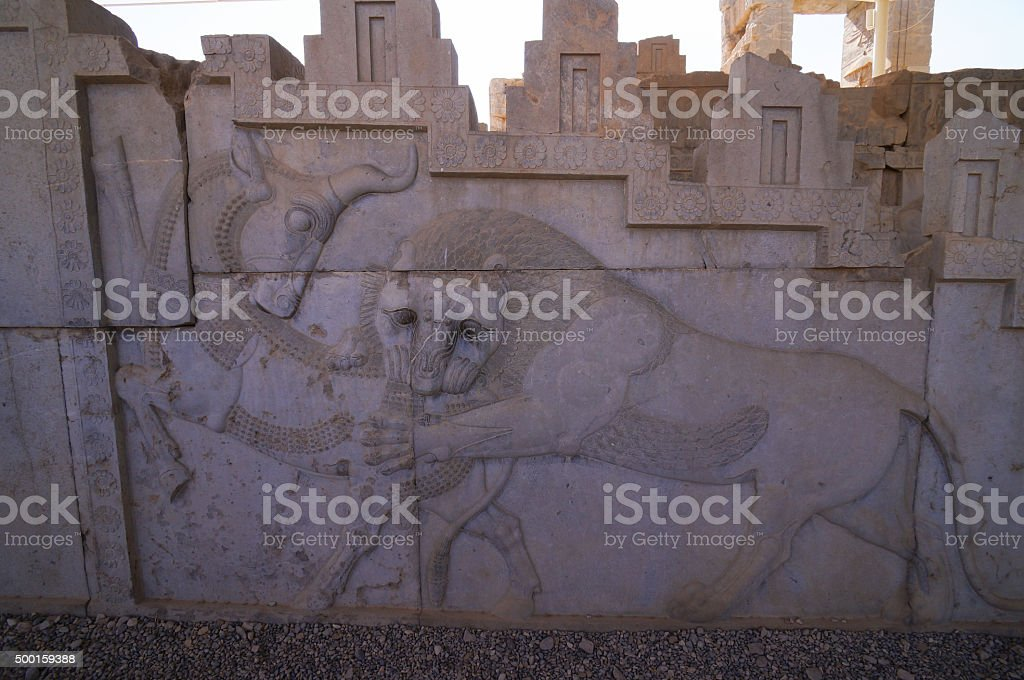 Bas-relief of a bull and a lion at Persepolis,Iran. stock photo