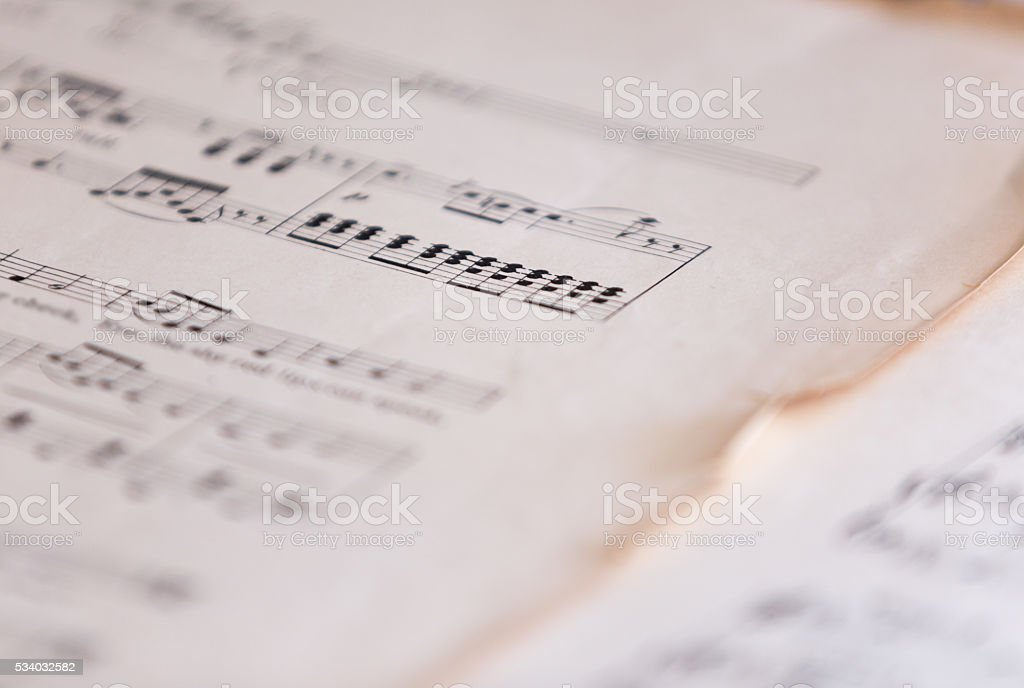 Bass Cleff On Old Sheet Music stock photo