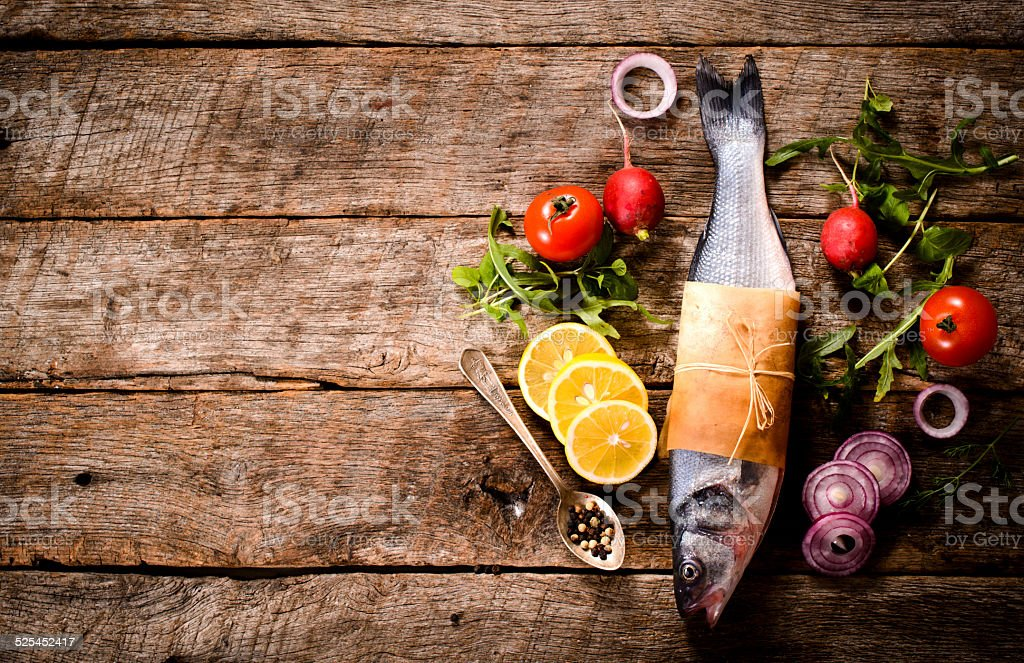 Bass fish and ingredients stock photo