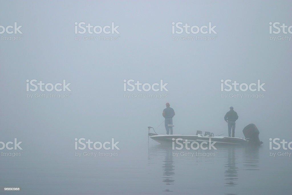 Bass fishing in the fog stock photo