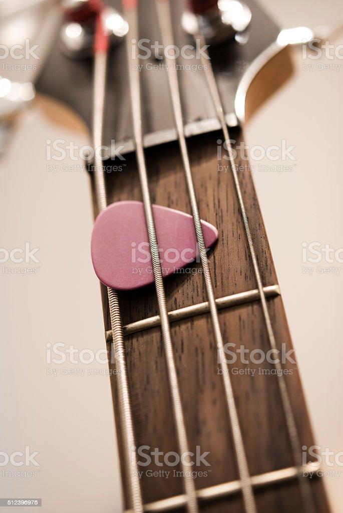 Bass Guitar and Plectrum stock photo