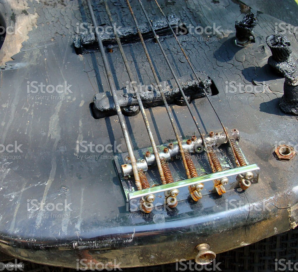 Bass Guitar From House Fire stock photo