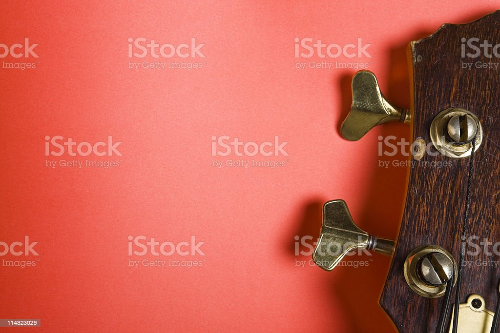 Bass guitar headstock on red stock photo