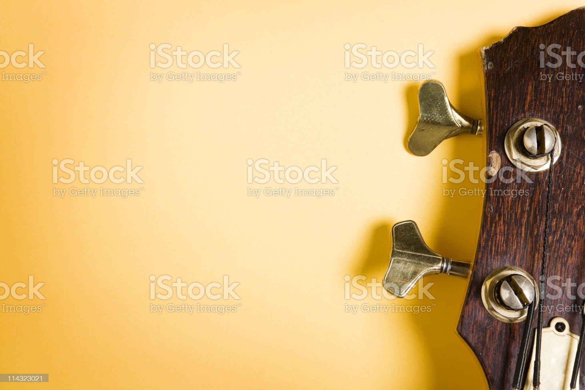 Bass guitar headstock on yellow royalty-free stock photo