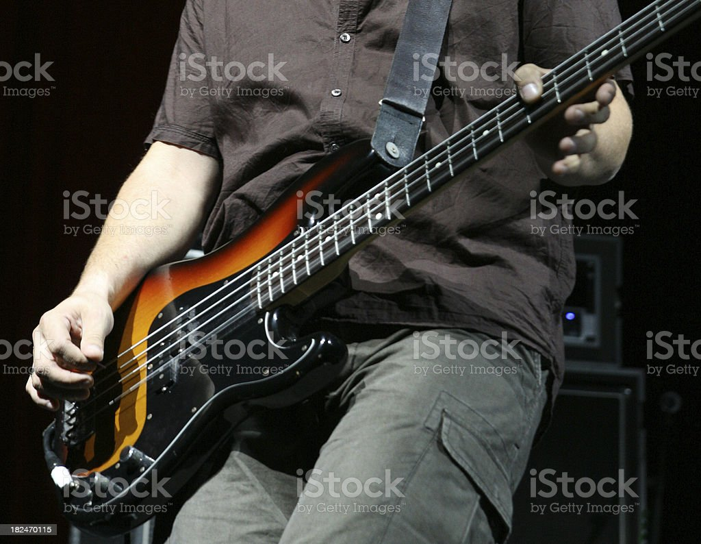 Bass guitar player on stage royalty-free stock photo