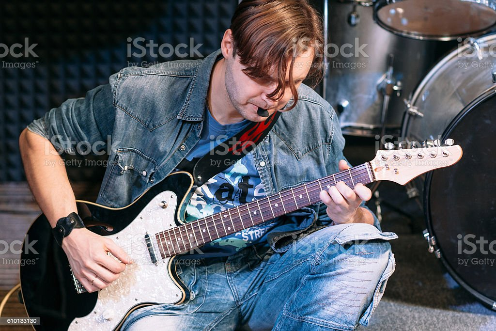 Bass guitar player playing solo, close-up stock photo