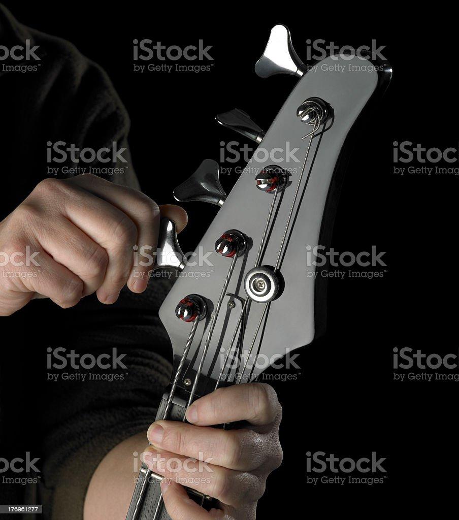 bass guitar tuning stock photo