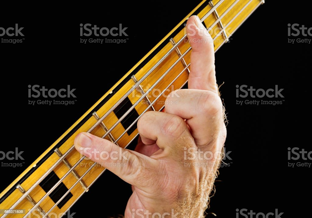 Bass guitar tutorial: Hand playing interval of minor third stock photo