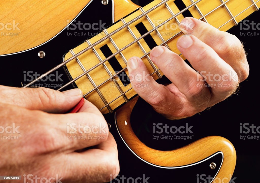Bass guitar tutorial: hands showing natural minor scale stock photo