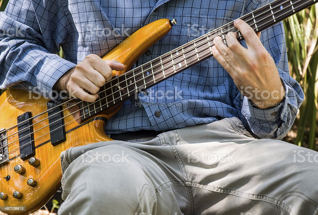 Bass Guitarist Performing Music Outdoors royalty-free stock photo