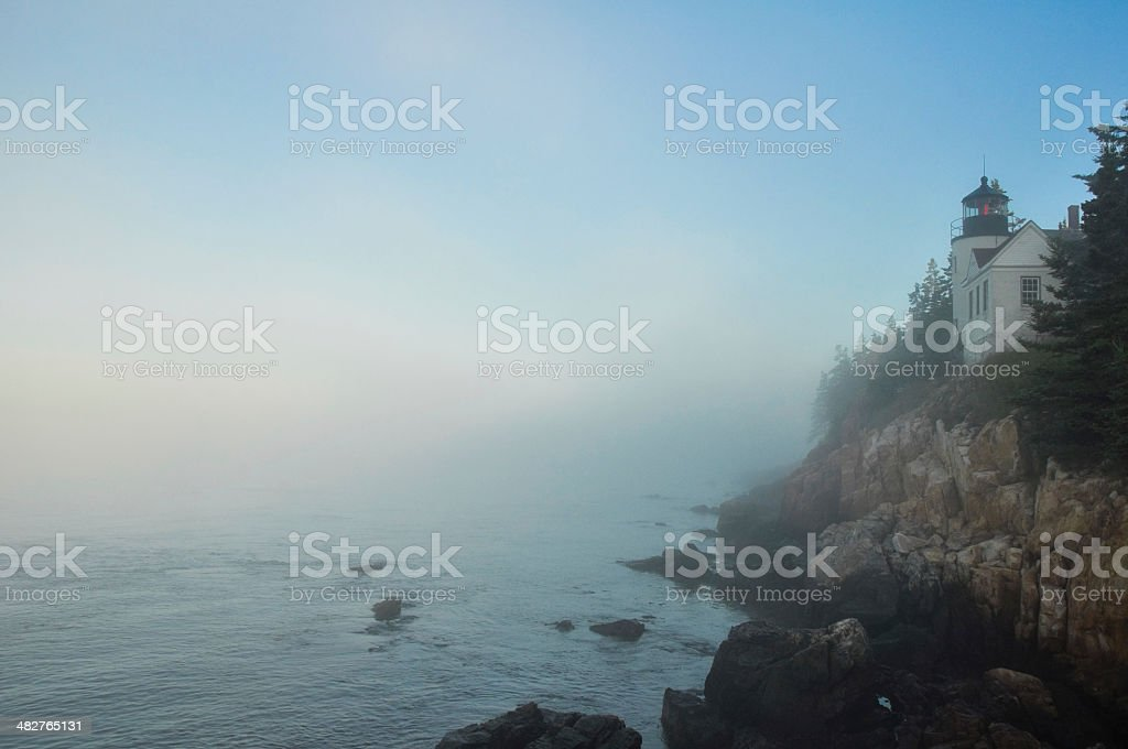 Bass Harbor Lighthouse in morning fog stock photo