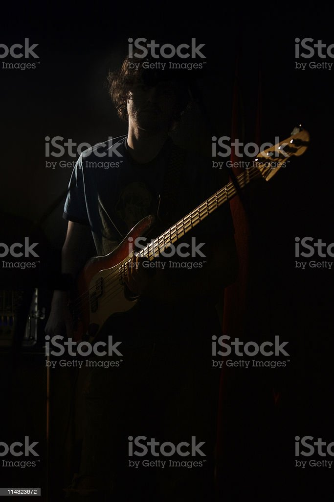 Bass player in low key royalty-free stock photo