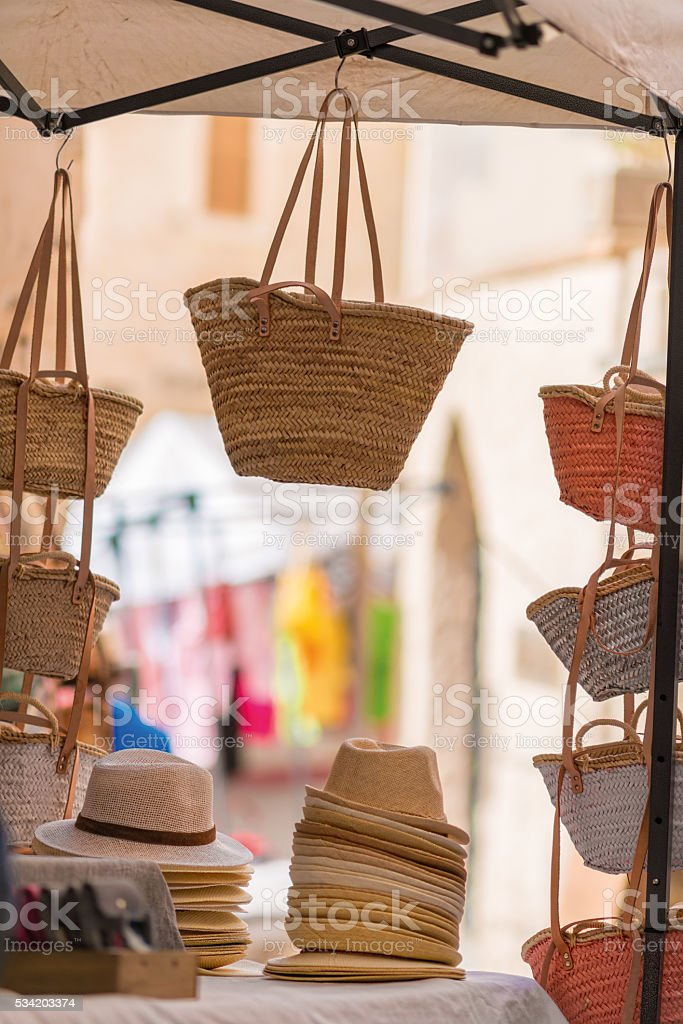 bast or straw heads and bags on a market stock photo