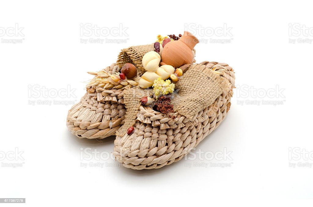 Bast shoes with products on a white background. stock photo