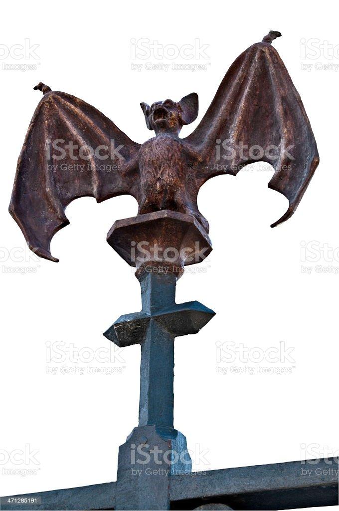 Bat in iron sitting on a metal cross stock photo