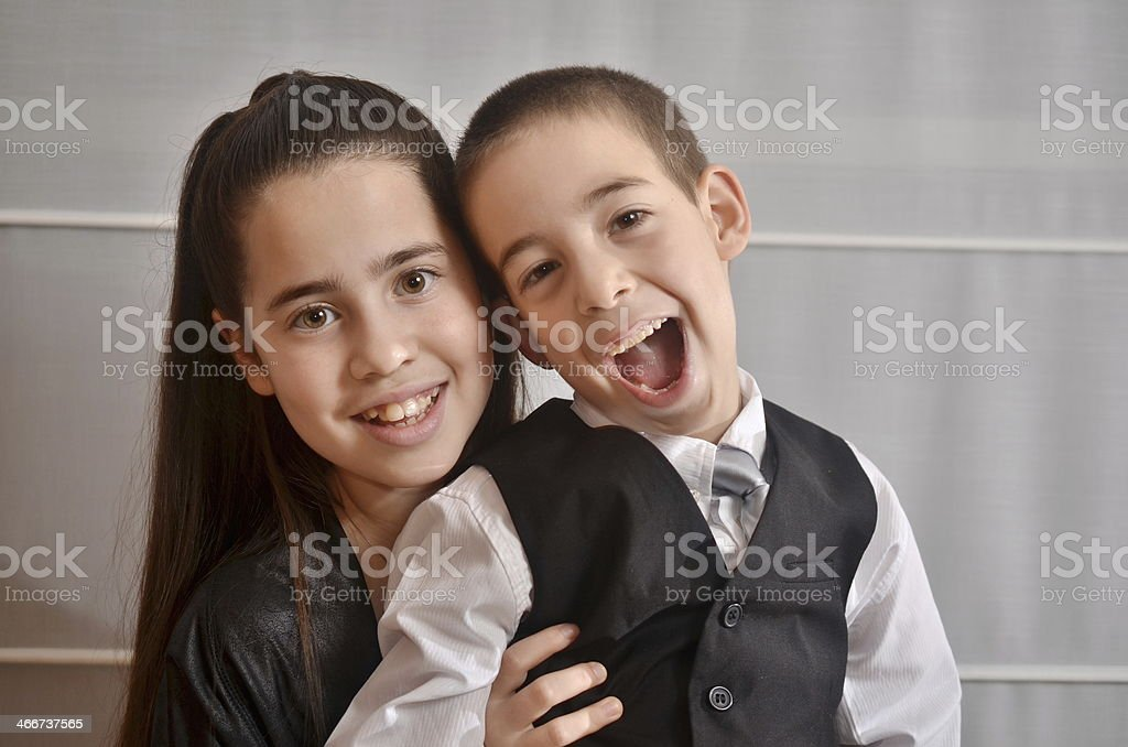 Bat Mitzvah girl with her brother stock photo