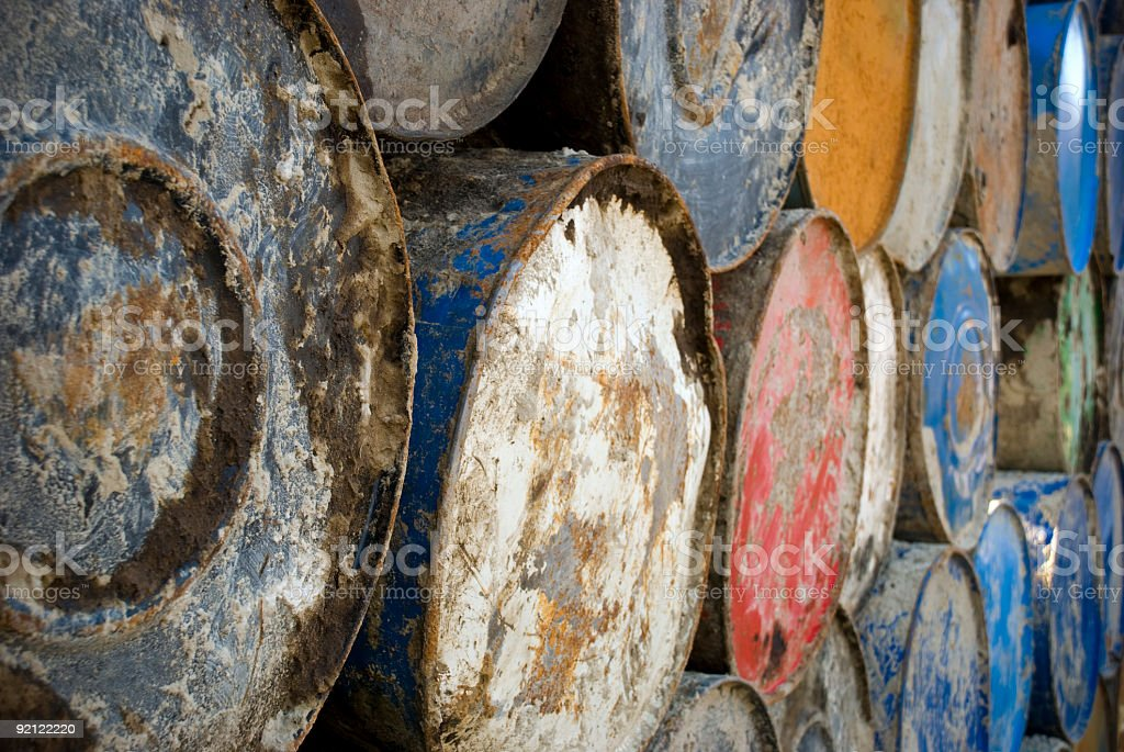 Batch of colourful metall barrels stock photo