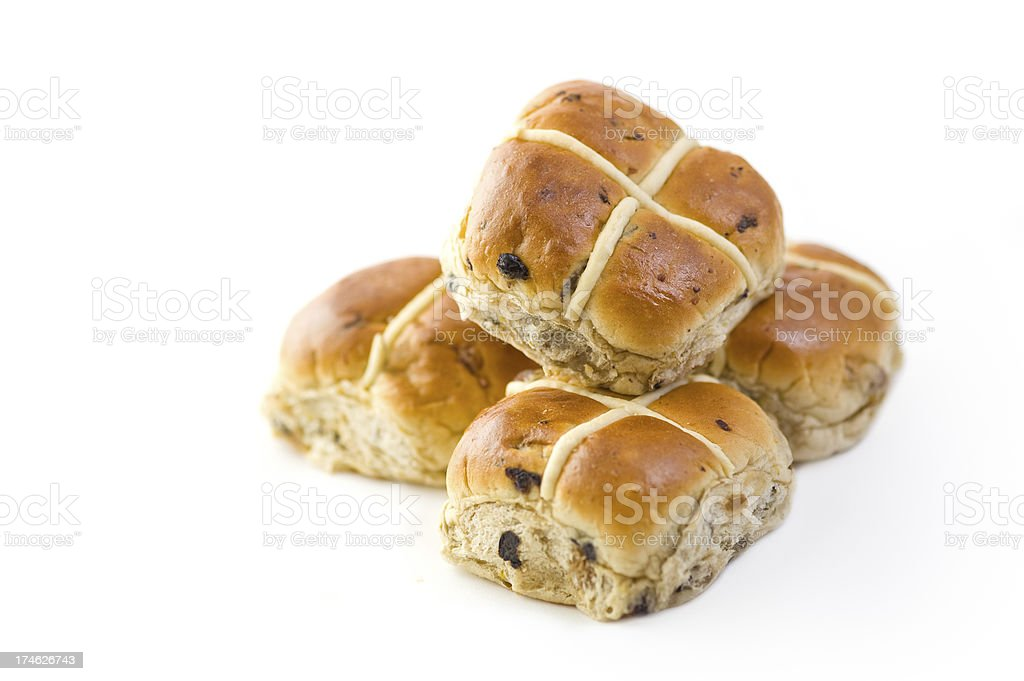 A batch of hot cross buns on a white background stock photo
