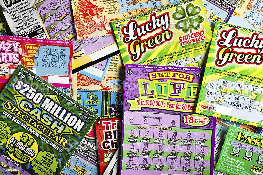 batch of scratched lottery tickets stock photo