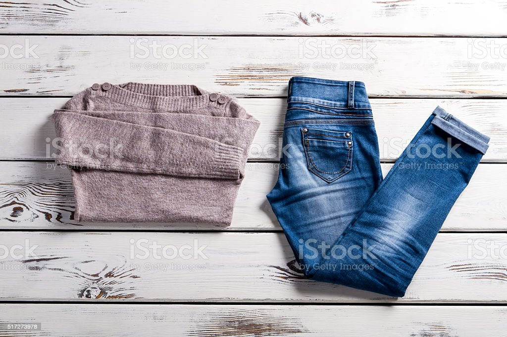 Bateau neckline sweater and jeans. stock photo