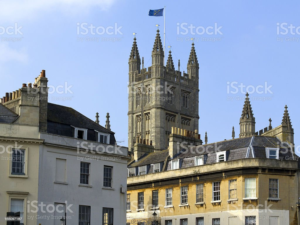 Bath Abbey rising above nearby buildings, UK stock photo
