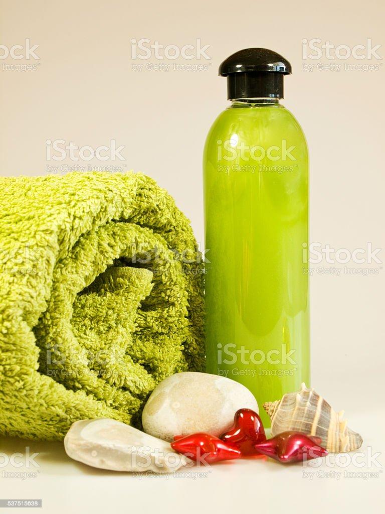 Bath accessories - shampoo and towel stock photo