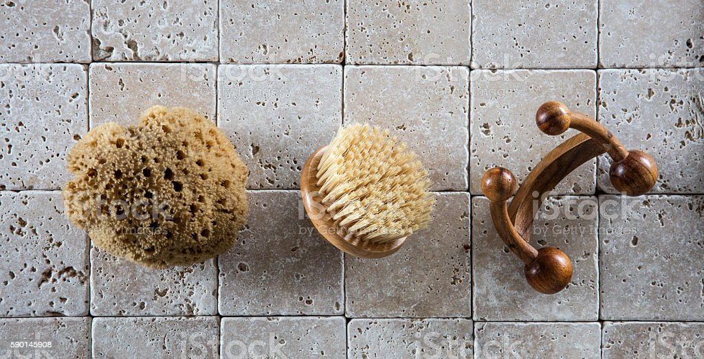 bath accessories with natural sponge, wooden body brush and massager stock photo