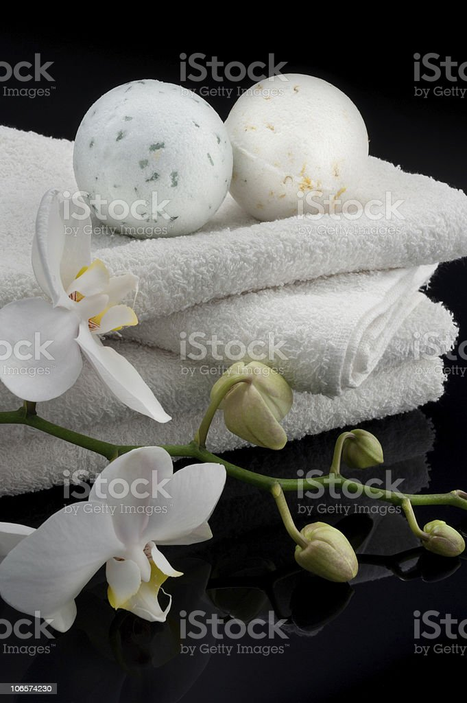 Bath balls with towels and orchid stock photo