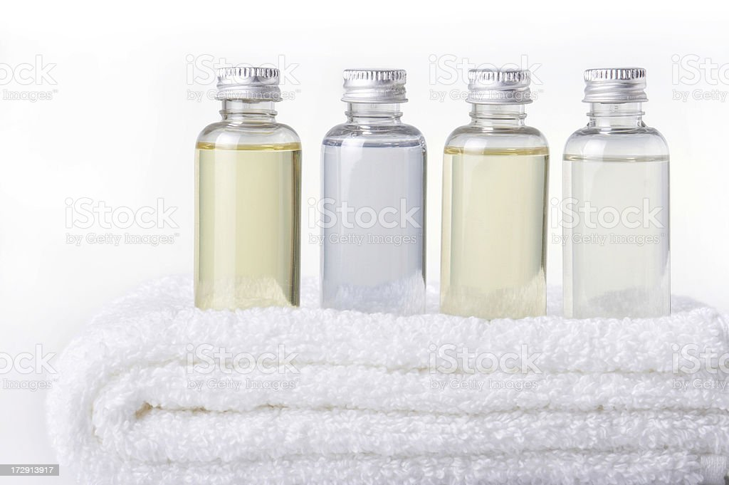 bath bottles on towel stock photo