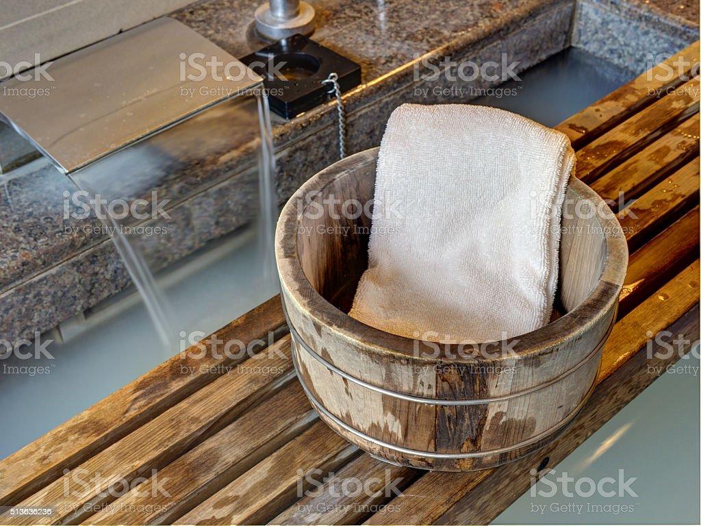 Bath bucket with a towel stock photo