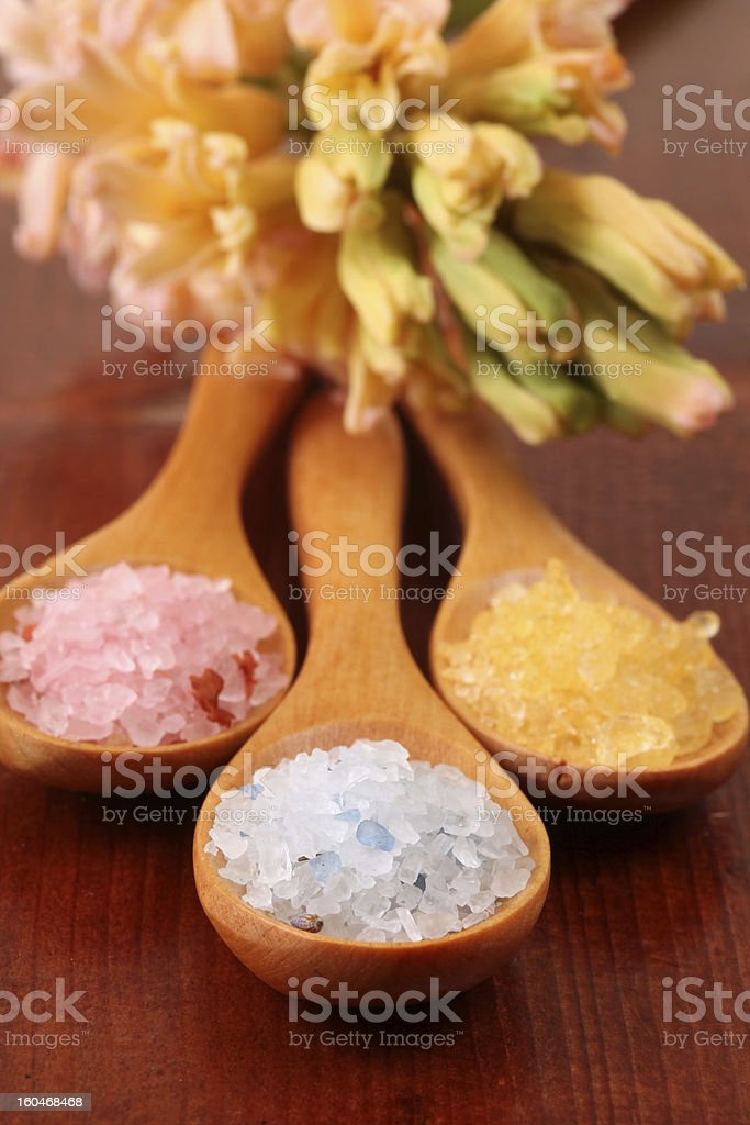 Bath salt in wooden spoons royalty-free stock photo