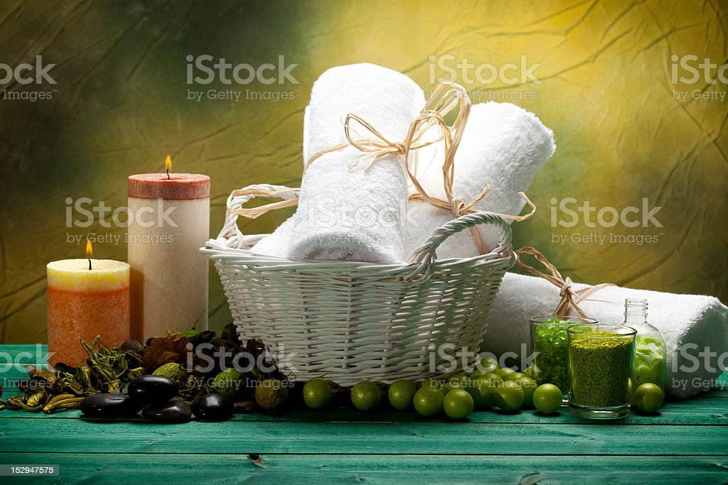 Bath salt, towels and candles - spa supplies royalty-free stock photo