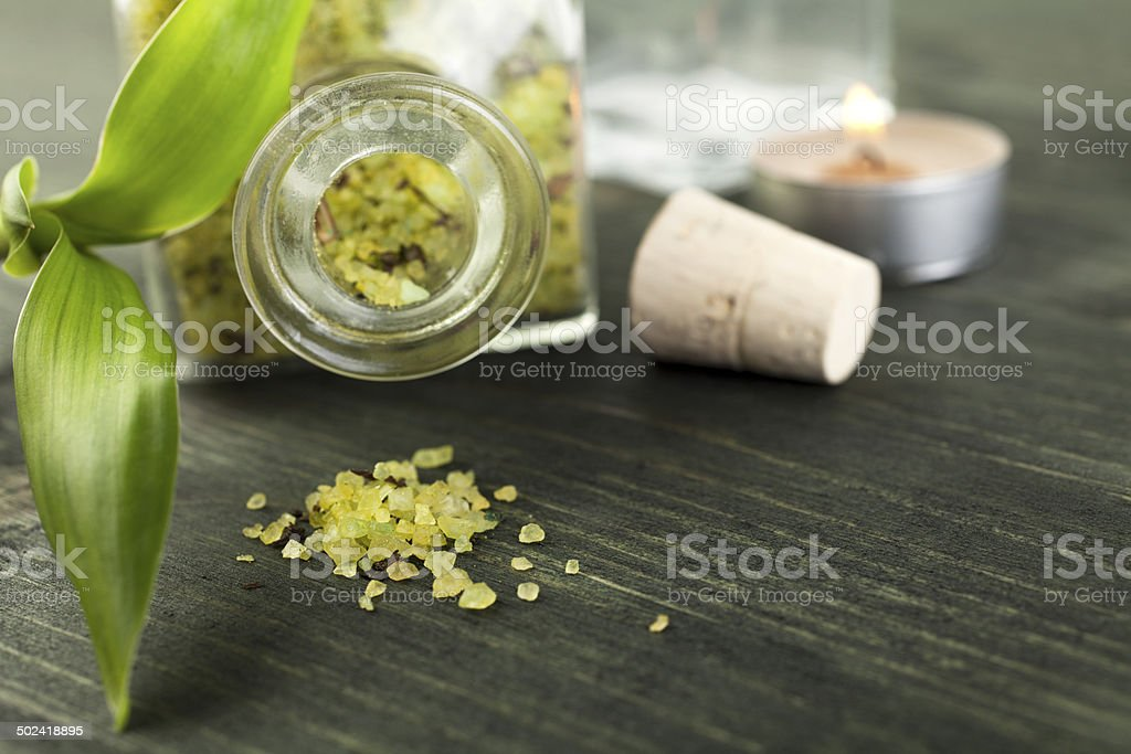 Bath salt with candle and pebble on wood royalty-free stock photo