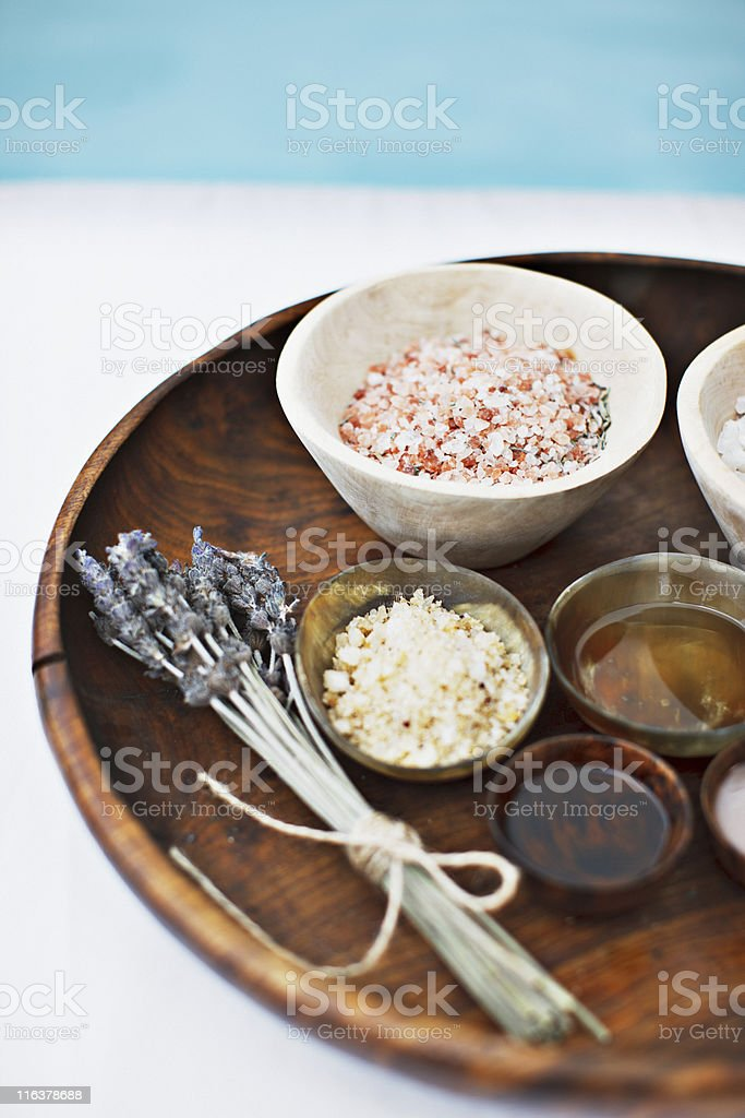 Bath salts and massage oils in bowls on tray royalty-free stock photo