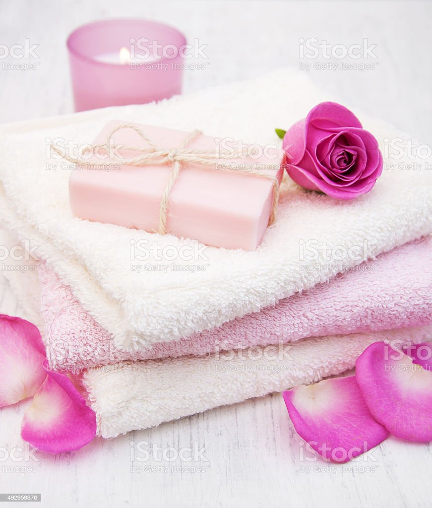 Bath towels and soap with pink roses stock photo