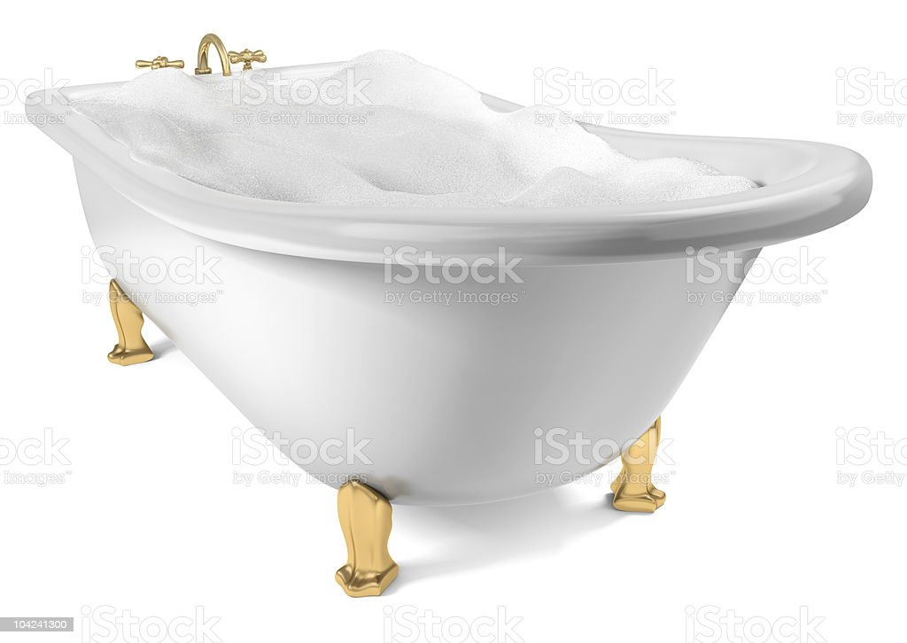 Bath with golden legs filled with water and bubbles stock photo