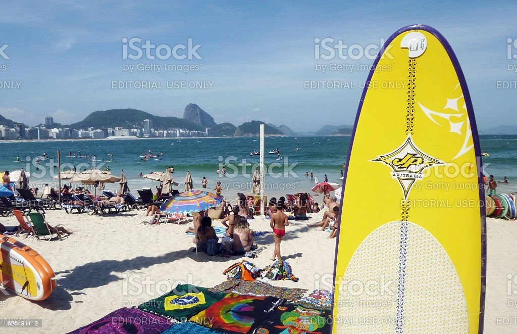 Bathers and stand up paddlers at Copacabana Beach stock photo