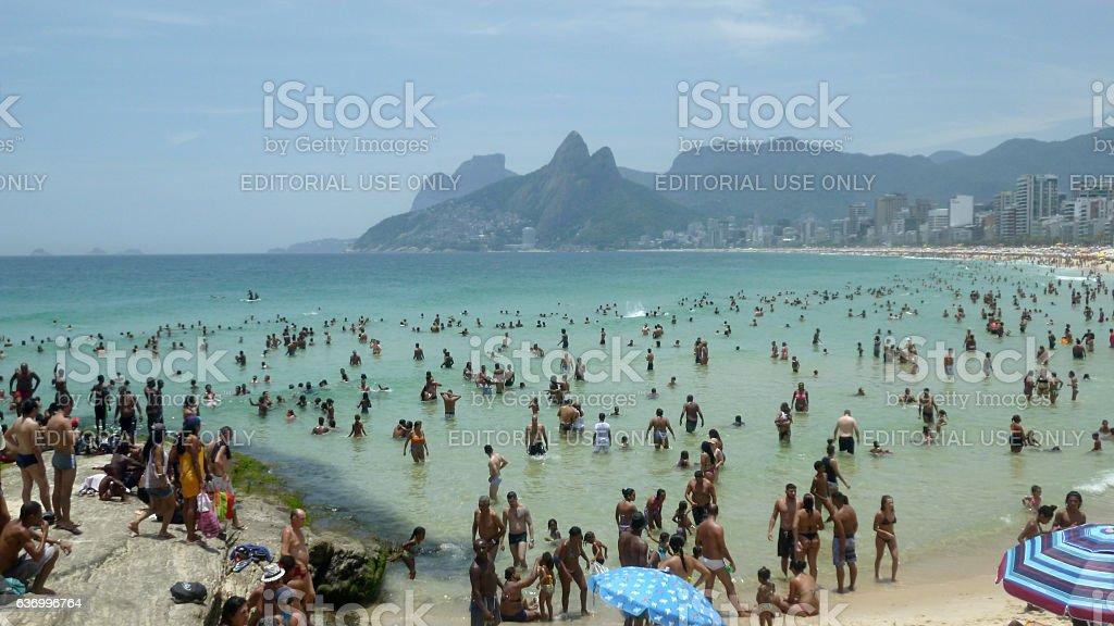 Bathers at Arpoador beach in Rio de Janeiro stock photo