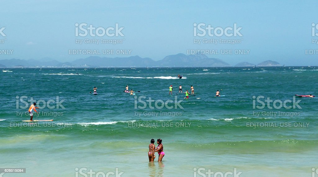 Bathers, jet skis and stand up paddlers in Copacabana stock photo