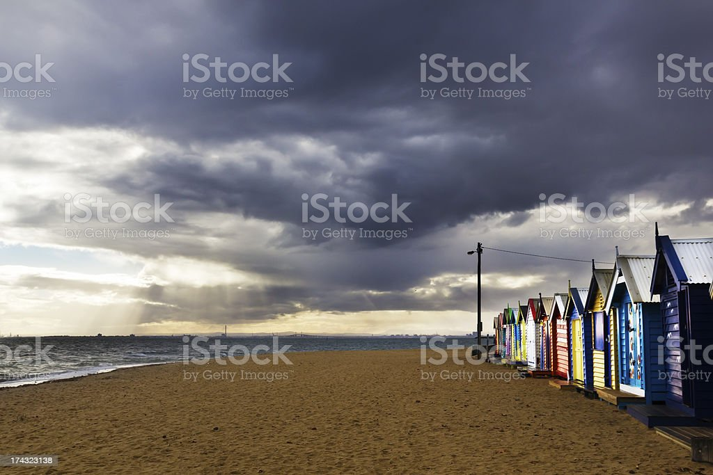 Bathing Boxes On a Cloudy Beach in Melbourne, Australia royalty-free stock photo