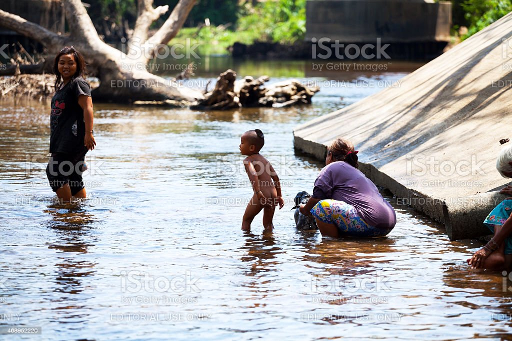 Bathing day of Thai family in river Phetchaburi stock photo