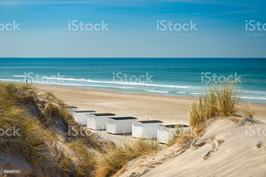 Bathing huts and Dune grass on Danish beach stock photo