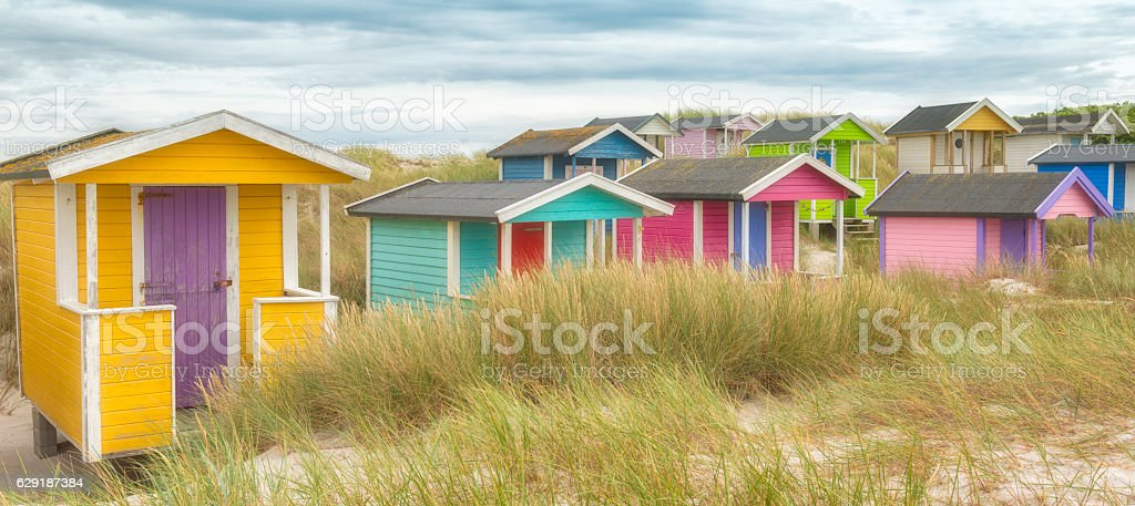 Bathing huts in the dunes stock photo