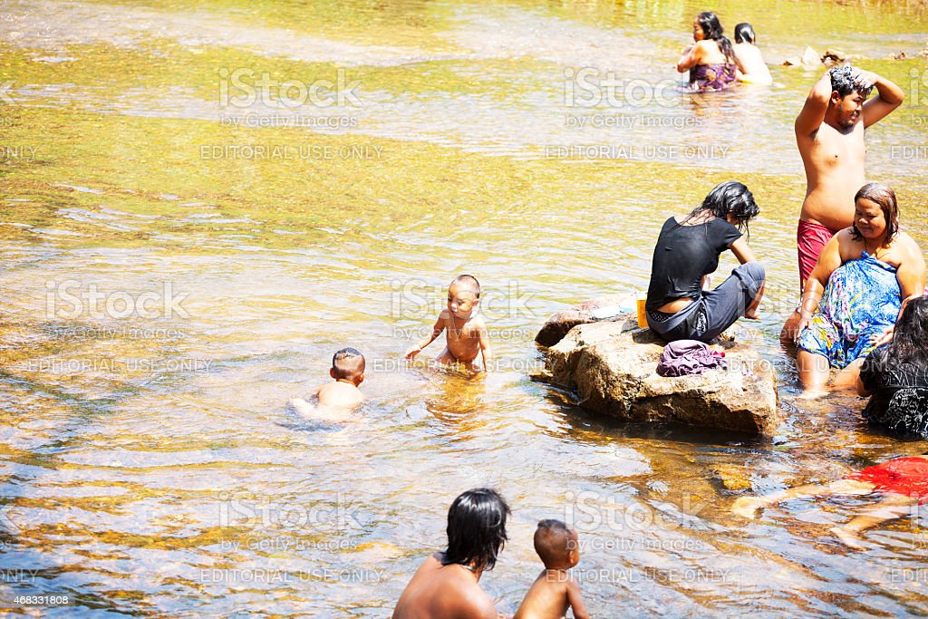 Bathing Thai familiy in river Phetchaburi stock photo