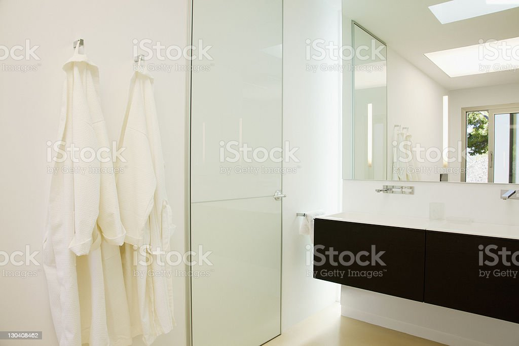 Bathrobes hanging in modern bathroom royalty-free stock photo