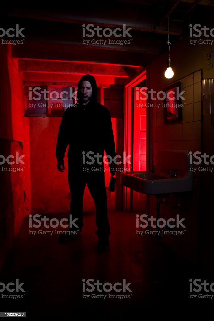 Bathroom Basement with Scary Killer Holding Knife, Copy Space royalty-free stock photo