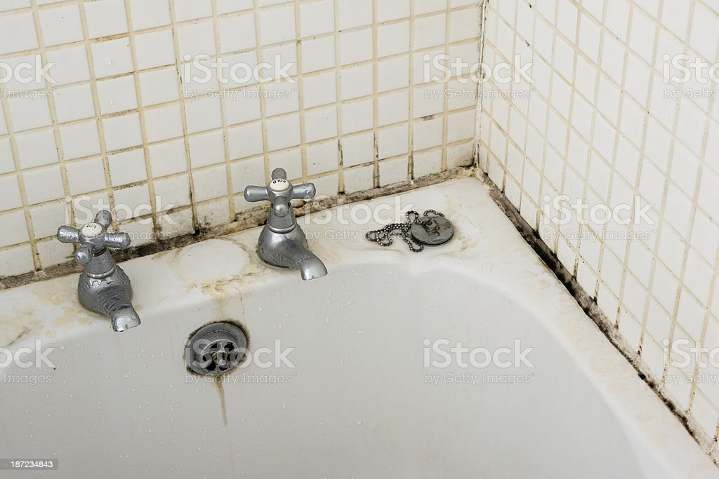 Bathroom dirt and mould on grouting and tiles near taps stock photo