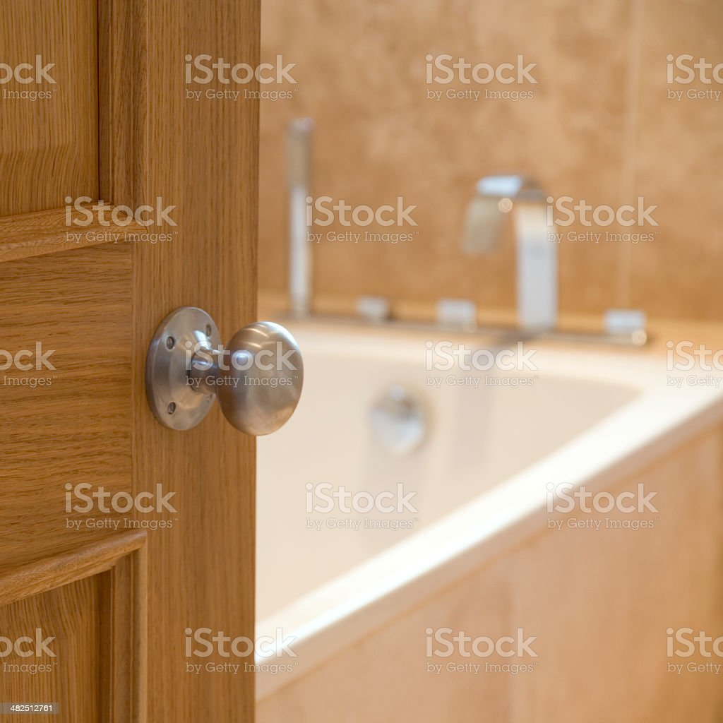 Bathroom door opening stock photo