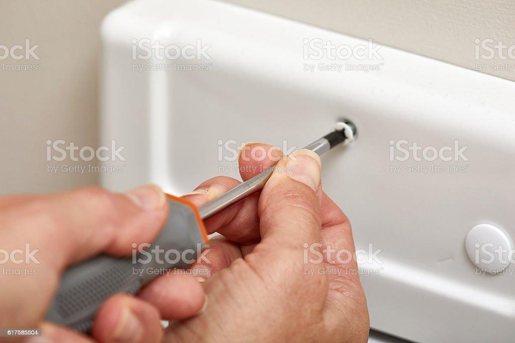 Bathroom fan repair. stock photo