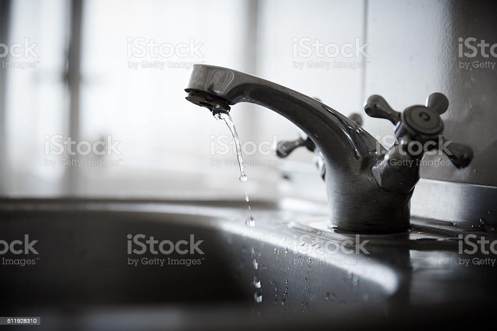 Bathroom faucet stock photo